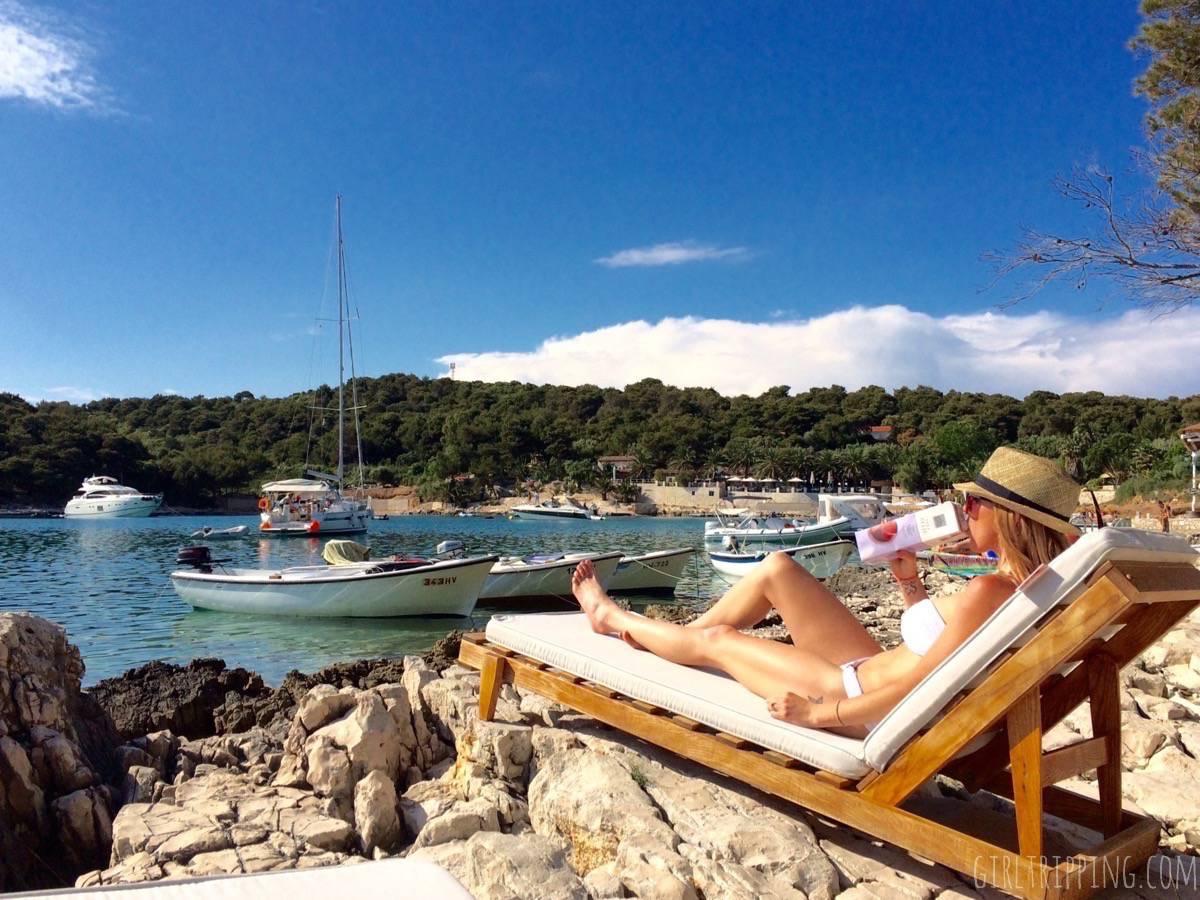 Melissa-hvar-lounge-sunbathing-boxed-wine-beach-boats